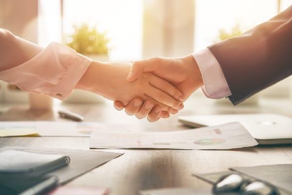 women shake hands